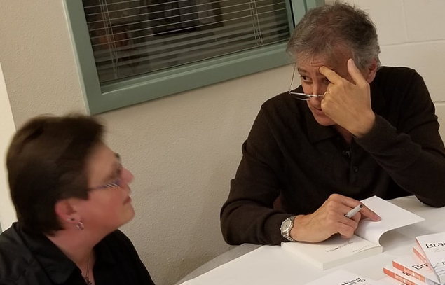 Person About To Sign His Book